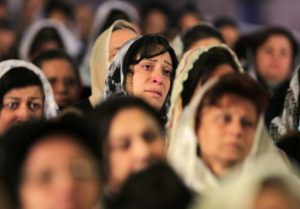 Coptic Christian women attend prayers in Cairo for Egyptians said to have been beheaded in Libya