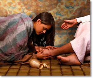 woman anointing Jesus feet
