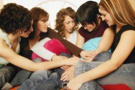 women-praying-together